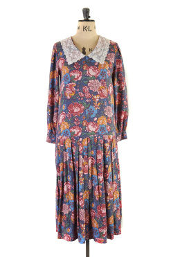 A vibrant winter vintage dress that is ideal for a special occasion or a glamorous day out.