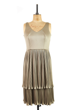 original vintage cocktail dress by Carnegie of London. Made in shimmering green, the '60s frock has a v neckline & tiered skirt