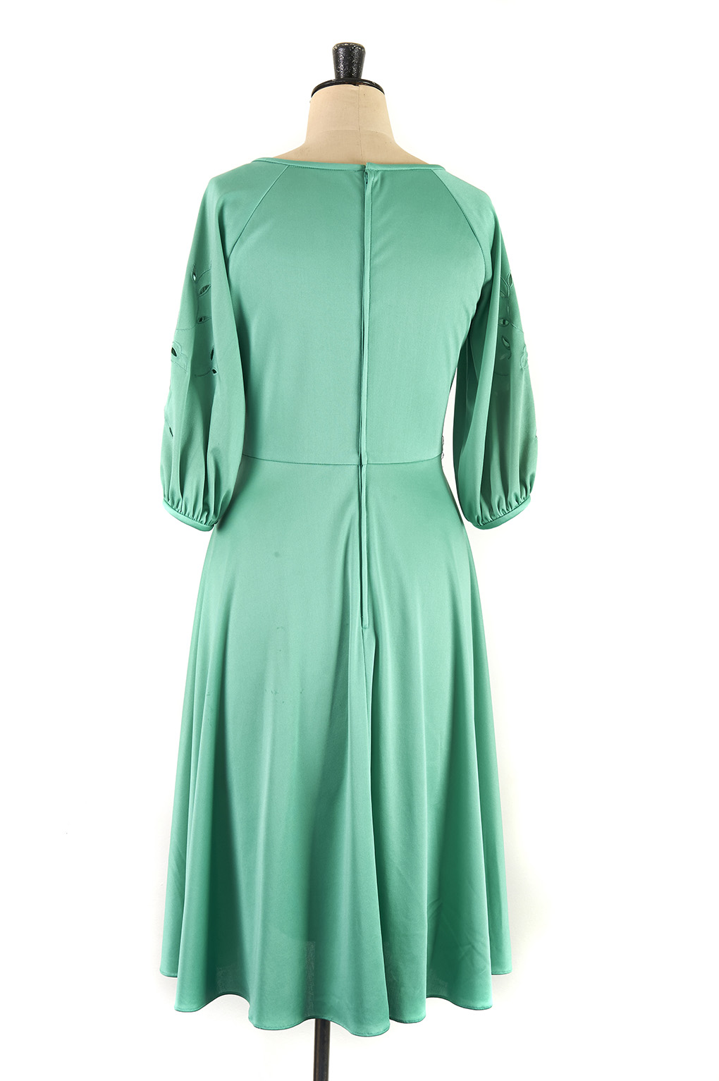 Vintage green dress with detailing on arm